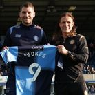 Wycombe Wanderers have signed experienced striker Sam Vokes from Stoke City.