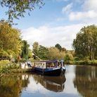 Picturesque landscape of a narrow boat moored on the Avon river awaiting tourists to cruise down the