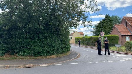 Police officers block Meadow Close in Narborough after a fire at a bungalow.