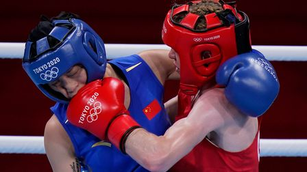 Britain's Charley-Sian Davison, right, exchanges punches with China's Chang Yuan during their women'