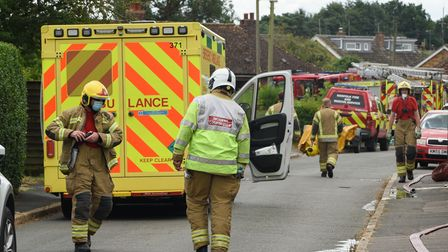 Firefighters attending the scene of a bungalow fire on Meadow Close in Narborough. Picture: Danielle
