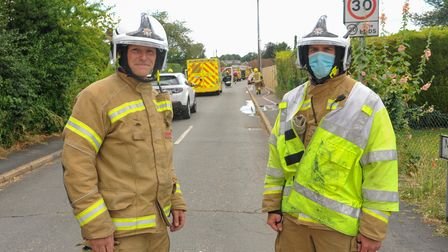 Firefighter Peter Oxford and King's Lynn station manager Dean Lacey at the scene of bungalow fire on