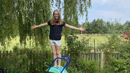 Millie Hyett, 10, wants to protect the field behind her house