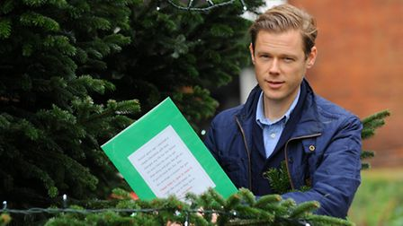 Alex Walton is giving out envelopes randomly hiding them around Norwich. They contain a Christmas st