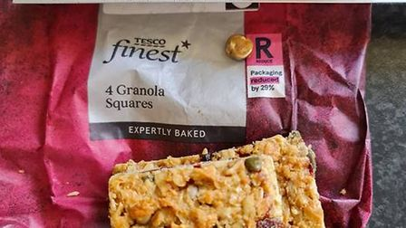 A gold filling, a Tesco bag of 4 Granola squares, and a ruler to show the size, in Great Dunmow, Essex