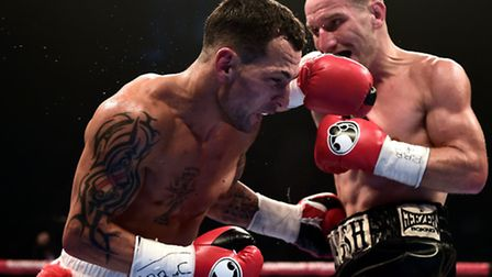 Ryan Walsh (right) on his way to defeating Samir Mouneimne (left) to win the British featherweight t