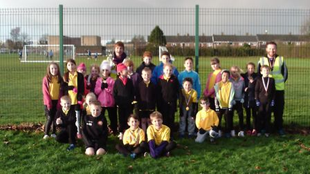 Heartsease Primary Academy's cross country team with PE co-ordinator Tom Stansfield, far right. Subm