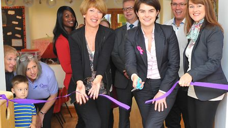 Chloe Smith cuts the ribbon to reopen the refurbished Once Upon a Time nursery school on Constitutio