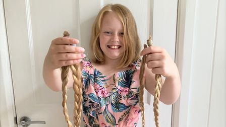 10-year-old Mia Couzens (pictured) from Soham, with her 18 inches of hair for the Little Princess Trust charity.