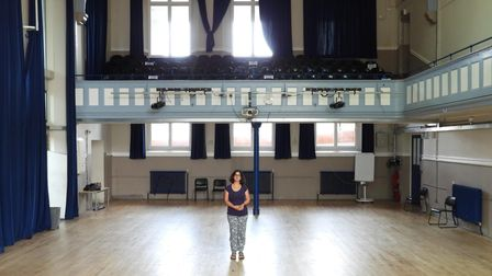 Sarah... almost lost in the vast school hall at Raine's Foundation