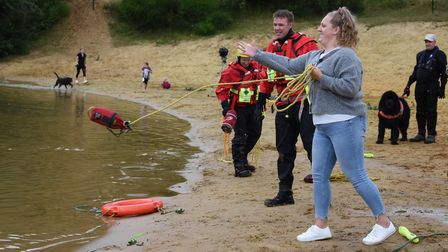 Greta Price of the Access Migrant Support charity learning how to use a throw line during water safe