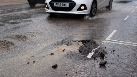 Water gushes out of one of two sinkholes which have opened up in Rouen Road where there is repairs i