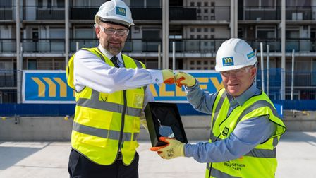 Mulalley Construction'sLee Walsh (left) with mayor Biggs on top of things at Barnsley Street building site