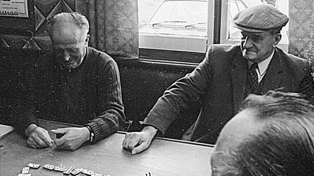 Playing dominoes at the Railway Tavern, Shippea Hill, just before it closed as a pub.