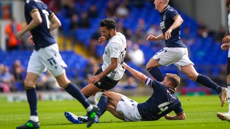 Macauley Bonne is challenged from behind by Shaun Hutchinson.