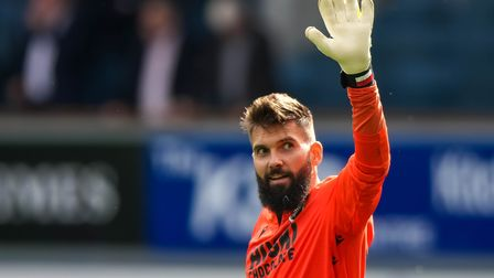Former Town keeper Bartosz Bialkowski, back at Portman Road with Millwall, acknowledges Town fans as