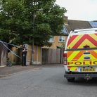 A police officer stands by the alleyway cordon at the back of a property on Middleton Crescent in Ne