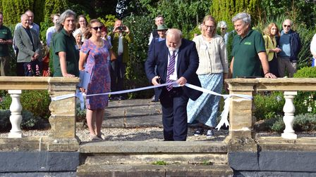 Councillor Martin Foley cuts the ribbon at the Gardens of Easton Lodge, Little Easton, Essex
