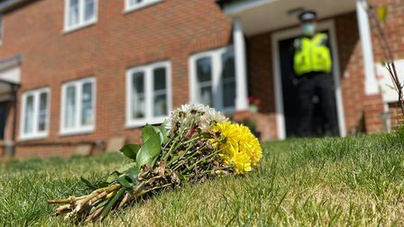 Flowers laid at a home in Shipdham where a woman in her 30s was found dead.