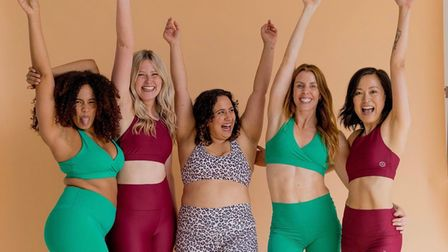 Carly Rowena, second from right, and some of her followers launching her first activewear range, CR x Halo