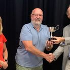 Francis Pepper receiving the Iona Morton Cup from Iona's son and daughter Chris Morton and Annabel Birch.