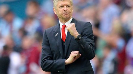 Arsenal manager Arsene Wenger is one of the greats for Norwich City rival Alex Neil. Photo: Anthony