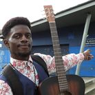IbrahimKargbo... strumming for support to keep St Andrew's youth club open