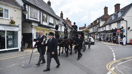 The funeral procession for Peter Green goes through Wymindham town centre with many of his friends a