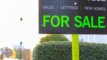 For Sale sign displayed on a British street