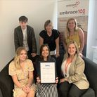 Chief Executive Anne Campbell (back row middle) and the Embrace team with their national award for outstanding services.