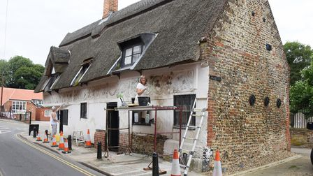 Work being carried out to restore the decorative pargeting on the 500-year-old Bishop Bonner's Cotta