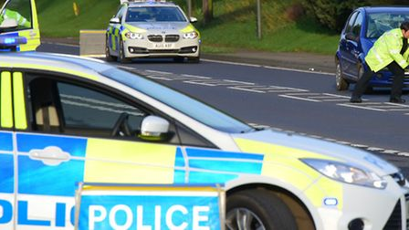 Police investigate the fatal accident on the A140 on Sunday afternoon in Newton Flotman. PHOTO BY SI