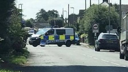 Police van shuts off Hundred Road in March after it split open