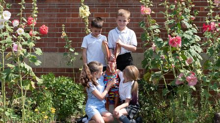 Children from Eye Primary School with one of the colourful hares. Picture: Sarah Lucy Brown