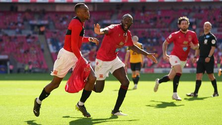 Morecambe's Carlos Mendes Gomes (left) celebrates scoring their side's first goal of the game from t