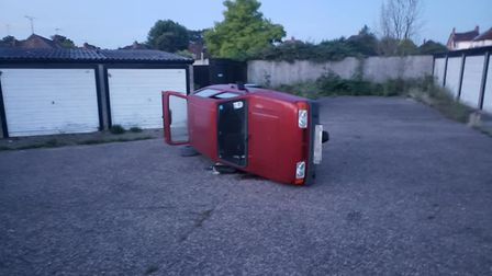 The Reliant Robin was tipped over outside a garage in Stowmarket