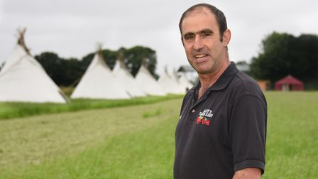 Farmer Algy Garrod with the teepees at his pop-up campsite at Themethorpe. Picture: DENISE BRADLEY