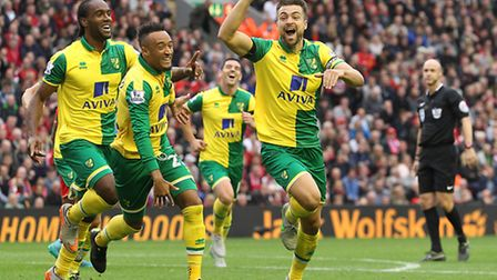 Captain Russell Martin celebrates his equaliser at Anfield one of many highs on the road for Norwic