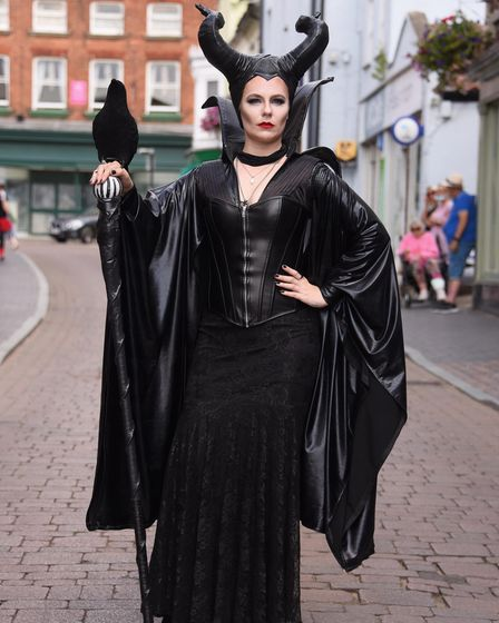 Maleficent (Sarah Bryden) joins people in Disney costumes in the streets of Fakenham to celebrate El