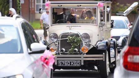 Elsie Gooderson's car touring through Fakenham to celebrate her fifth birthday as the town is turned