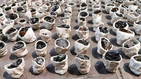 Rachel's performance piece entitled 'The two Metre Breaking Point' focuses on porcelain pots full of ash