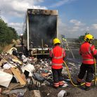 Fire crews clearing up after the lorry fire at Milton on the A14