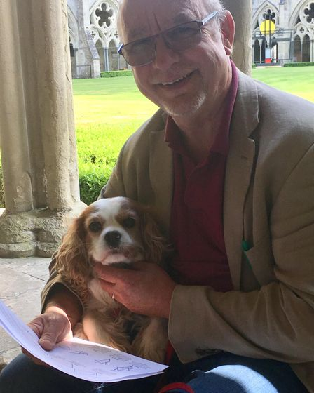 Retired teacher Simon Pearce, with his dog Milly