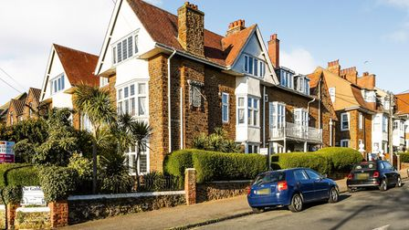 Huge brick-built Edwardian home off a main road with cars parked outside and bay windows