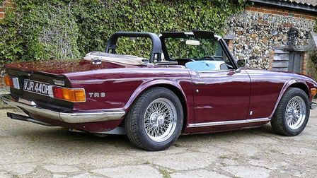 A classic red convertible that Alex and his team worked on
