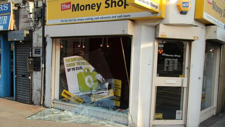Whole plate-glass window smashed at TheMoney Shop in Bethnal Green Road