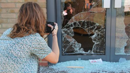 Snapof a snapper catching the damage from 2011 rioting the night before