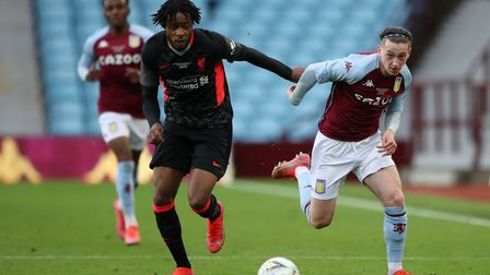 Aston Villa's Louie Barry and Liverpool's James Balagizi (left) battle for the ball during the FA Yo