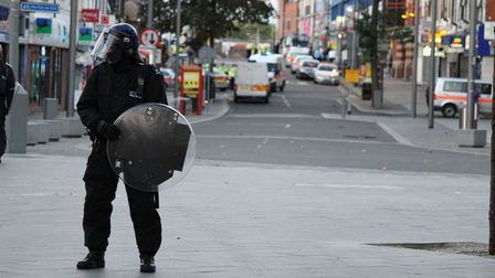 Riot police in Barking Town Centre after it was cleared of rioters on Monday
