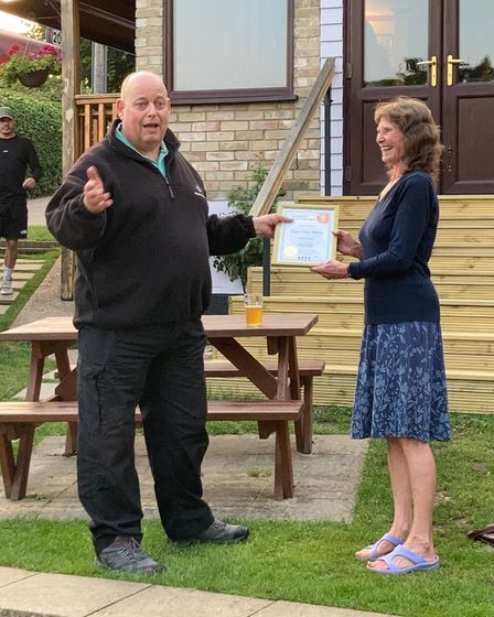 West Suffolk & Borders CAMRA chairmanChris Baileypresents Debbie Oliver with her 'Community Pub of the Year' certificate.